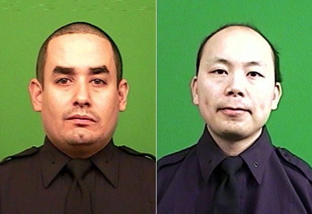 A polícia de Nova York divulgou fotos de Rafael Ramos e Wenjian Liu, os dois policiais mortos no Brooklyn na noite de sábado (20) (Foto: AP Photo/New York Police Department)