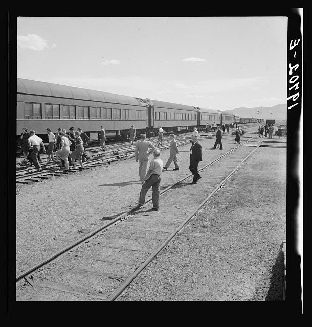 Railroad yards, Kearney, Nebraska. Overland train passengers go back to their cars after ten minute train stop on trip between San Francisco and Chicago