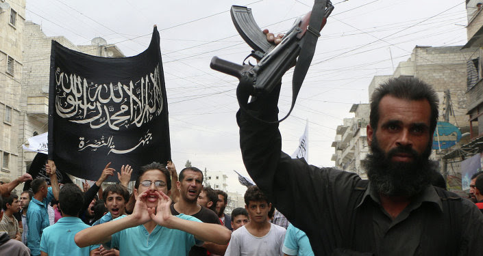 Supporters of the Al Nusra Front take part in a protest against Syrian President Bashar al-Assad and the international coalition in Aleppo on September 26, 2014