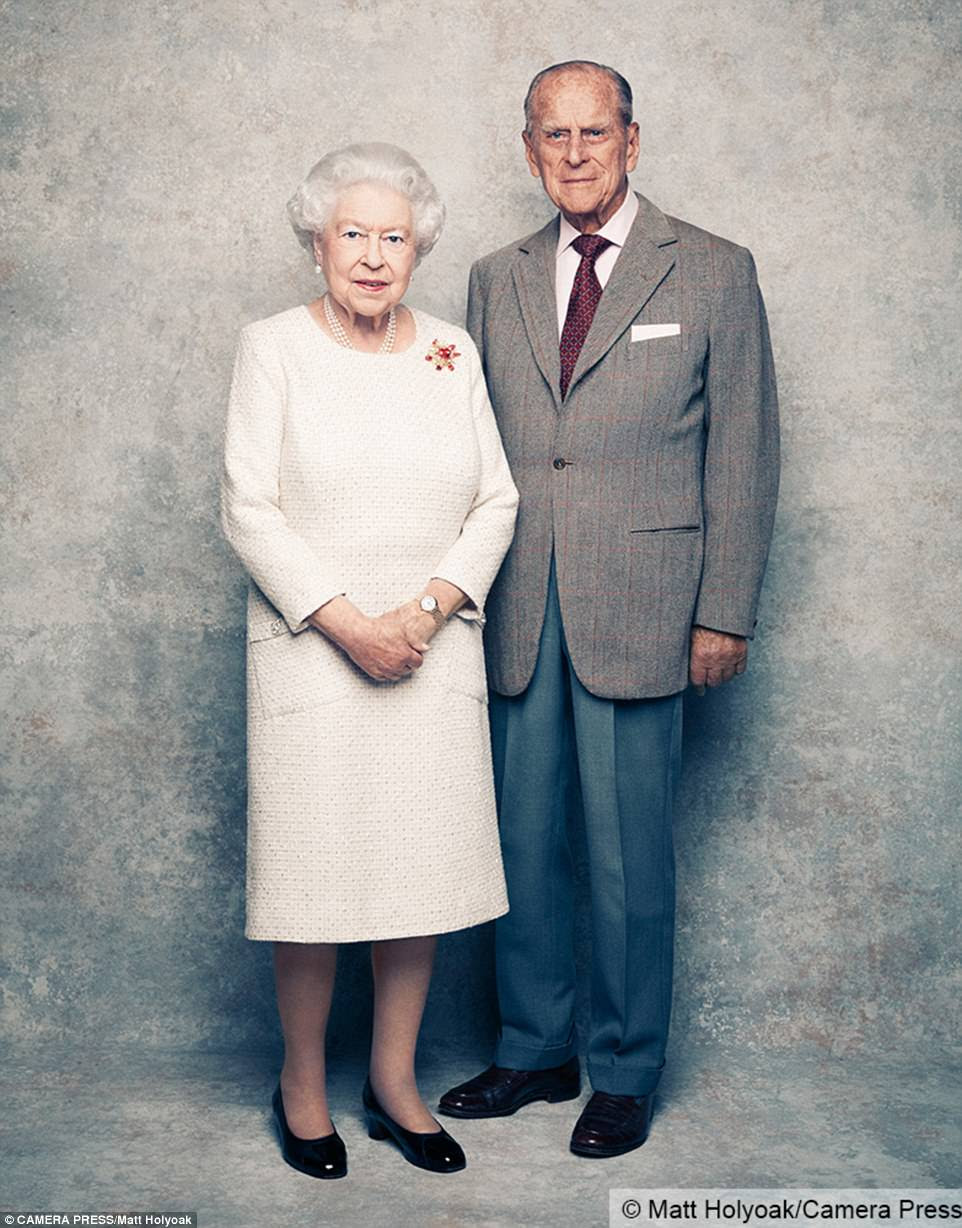 Enduring love: The Queen and Prince Philip are seen posing against a platinum-textured background in a new set of three photos released by Buckingham Palace to mark their 70th wedding anniversary