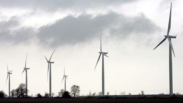 Wind turbines are shown at the opening of a 44-turbine wind farm near Port Alma.