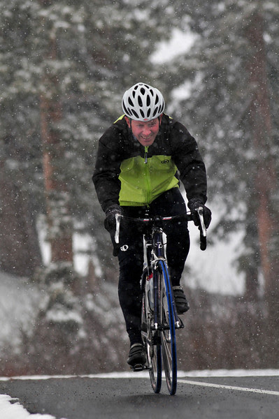 The Lizard happily pedals up Coal Bank Pass in the snow.  Happily being the key word.