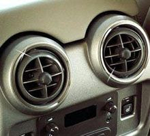 A car's air conditioning vents.