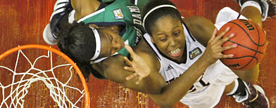 Texas A&M's Adaora Elonu puts up a shot under pressure form Notre Dame's Devereaux Peters in the first half of the women's NCAA Final Four championship game in Indianapolis on Tuesday. (AP Photo/Michael Conroy)
