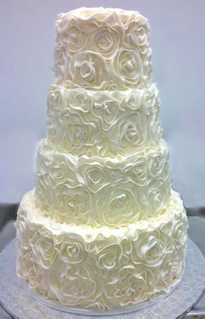 Elegant Wedding Cake with floral swirls from The Solvang