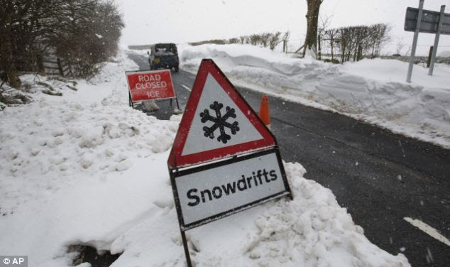 Danger signs: Signs have been put in place to warn drivers of treacherous roads due to severe snowdrifts in Lancashire