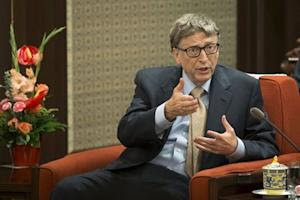 Microsoft co-founder Bill Gates gestures as he meets with China's Premier Li Keqiang in Beijing