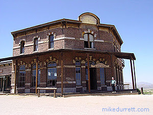 Mike finds himself on the steps of the Tombstone Saloon. Photo copyright 2003 Mike Durrett.