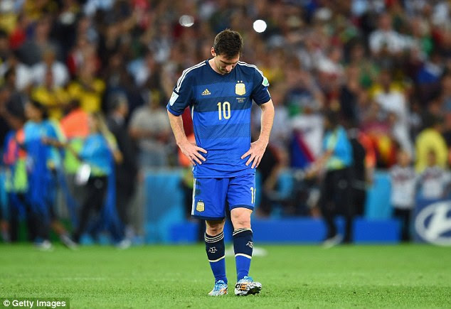 Dream is over: Lionel Messi looks to the ground after Germany win the World Cup at the Maracana
