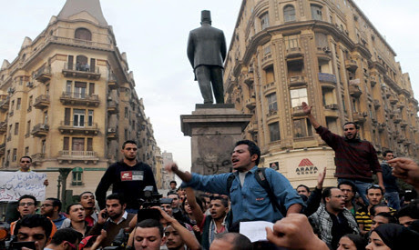Egyptian demonstrate against new laws to restrict political activity under the military regime. This march took place on November 27, 2013. by Pan-African News Wire File Photos