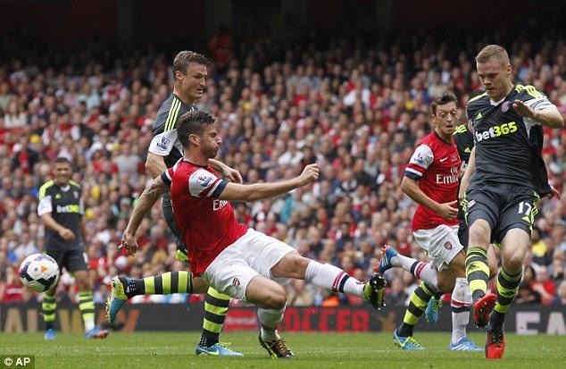 Off target: Giroud has his shot on goal rebound off Stoke City's Ryan Shawcross