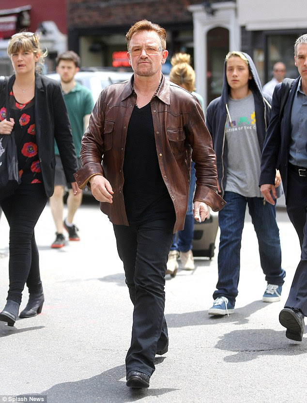 Ditched the dark locks: Bono looked a far cry from his trademark image, sporting patchy auburn locks as he walked through New York on Thursday