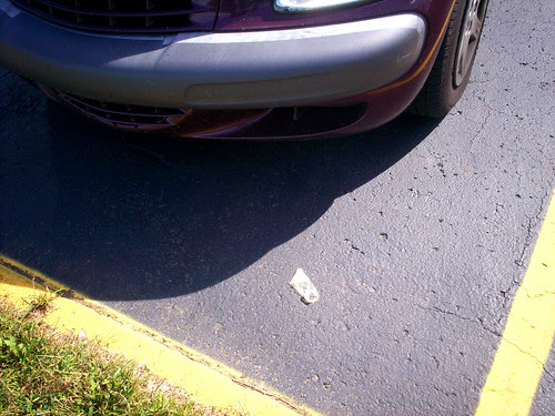 Condom in front of my car.