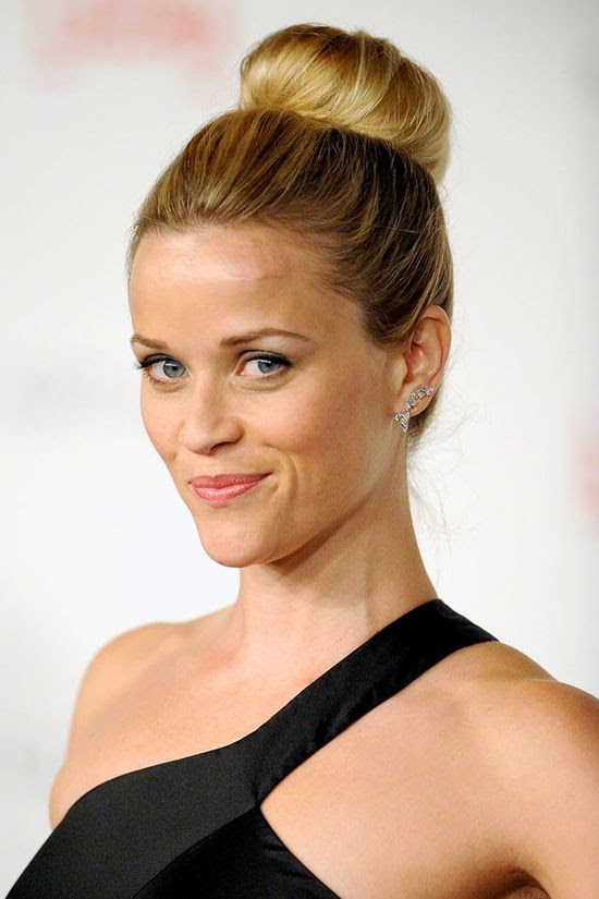 This season we'll be stepping out with our hair swept up into a tidy high ballerina bun, just like Reese Witherspoon. The bun should be playing peek-a-boo over the top of your head - make Reese your style guide for the look.