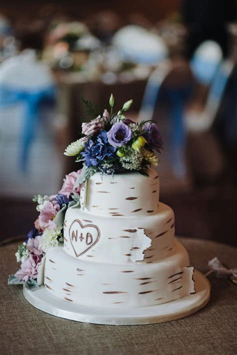 tree trunk wedding cake birch bark and wild flowers and