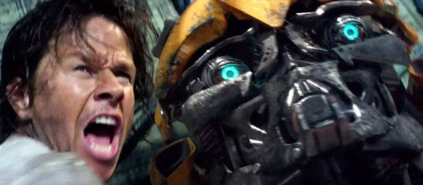 Cade Yeager (Mark Wahlberg) pleads to Optimus Prime (off-screen) not to strike down Bumblebee in TRANSFORMERS: THE LAST KNIGHT.