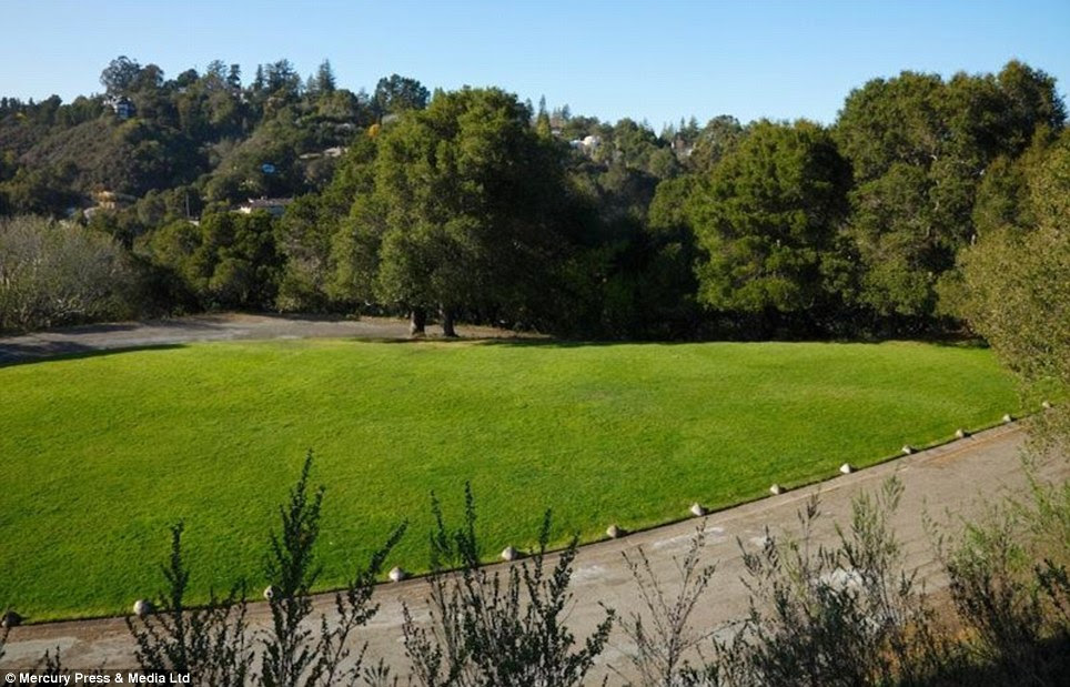 Way to mow: The new owners might need a little help to keep the grounds in good order