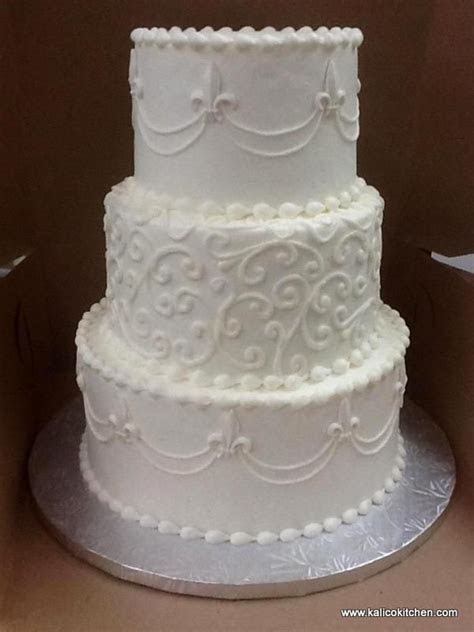 Wedding Cakes  3 tier, buttercream, white, Fleur de Lis