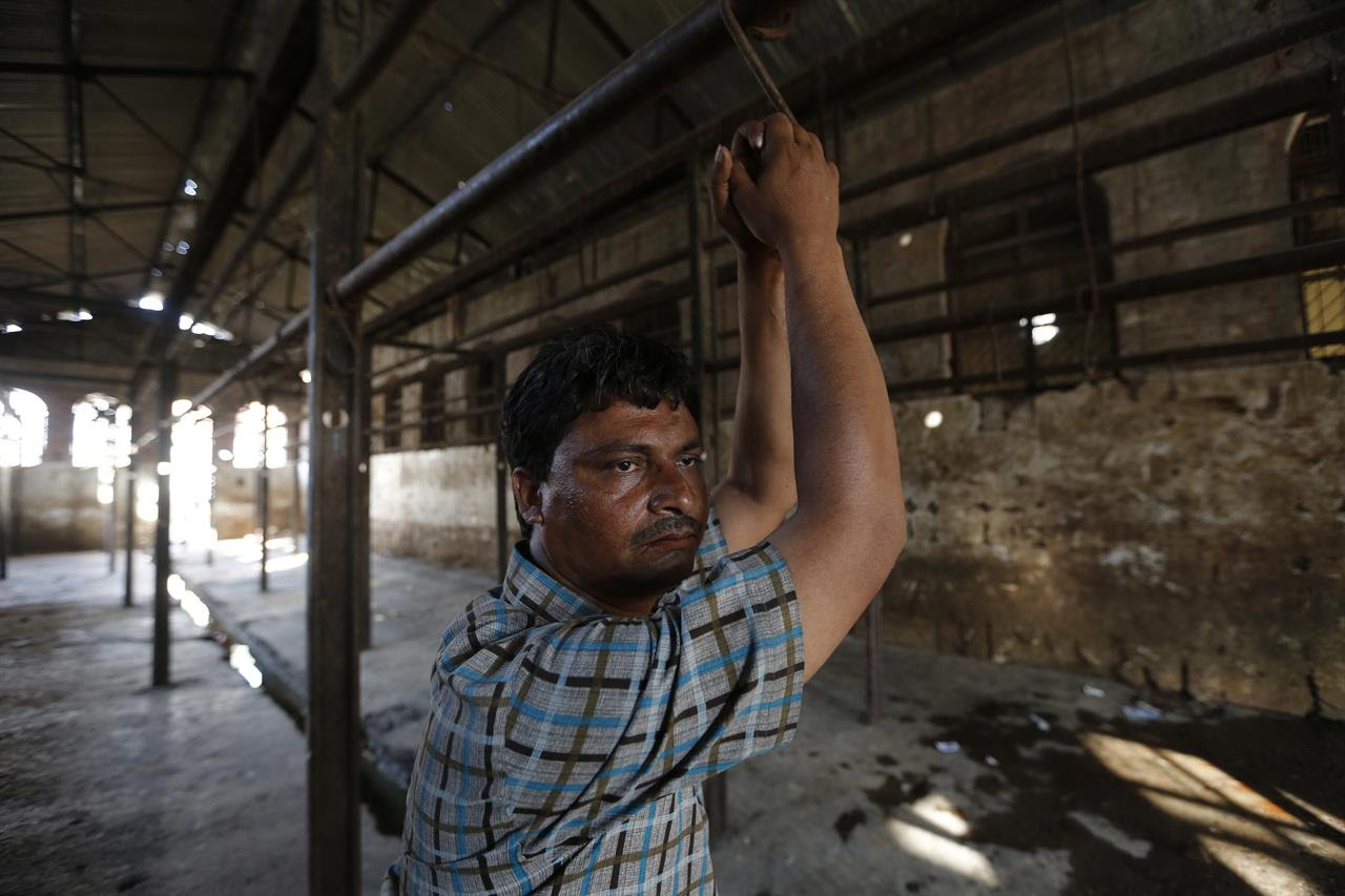 In this Sunday, March 26, 2017 photo, Mehta, 40, stands at a slaughter house where he used to work after it was shutdown by authorities in Allahabad, India. India's most populous state is running out of meat. After the Hindu right-wing Bharatiya Janata Party came to power in Uttar Pradesh this month on the back of a resounding electoral victory and named a Hindu priest-cum-politician as the state's chief minister, the government began cracking down on illegal slaughterhouses and meat shops.