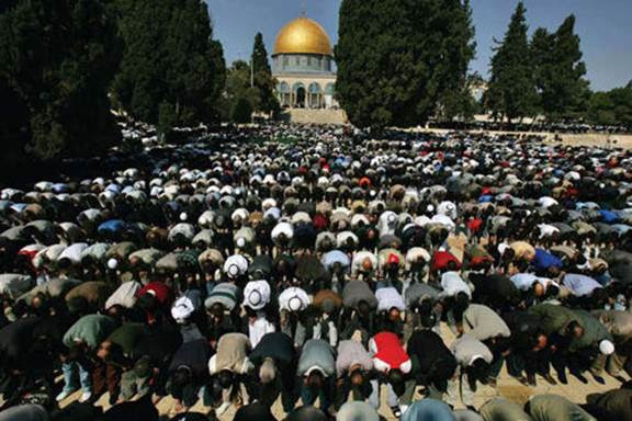 Thousands of Muslim worshippers pray during Ramadan on the Temple Mount in front of the Dome of the Rock shrine. (Muhammed Muheisen, Associated Press)
