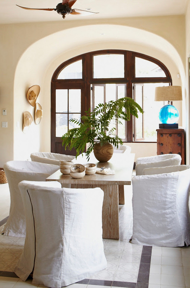 Dining Room. Mediterranean Dining Room with Slipcovered Chairs. Interior Design by Beth Webb Interiors.