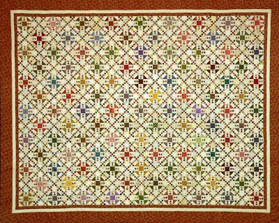 "Sue Garman scrap quilt - Omigosh - 1/2"" finished squares make up the nine patch units."