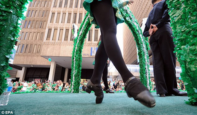 Cultural treat: An Irish dancer performed from toe to toe on one of the many parade floats in Atlanta