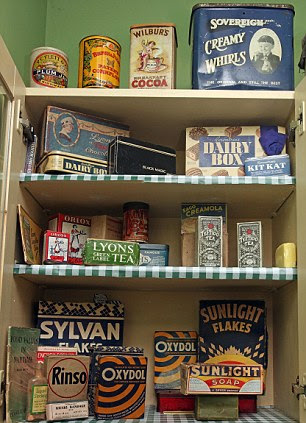 Stocked up with sweet memories: These old tins are purely for decoration, as is this period chocolate advert