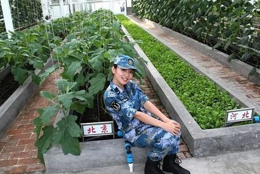 Fiery Cross Reef in South China Sea - Female Military Posing