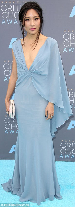Go with the flow: (L-R)Wendi McLendon-Covey,Jean Smart and Constance Wu picked floor-sweeping blue gowns