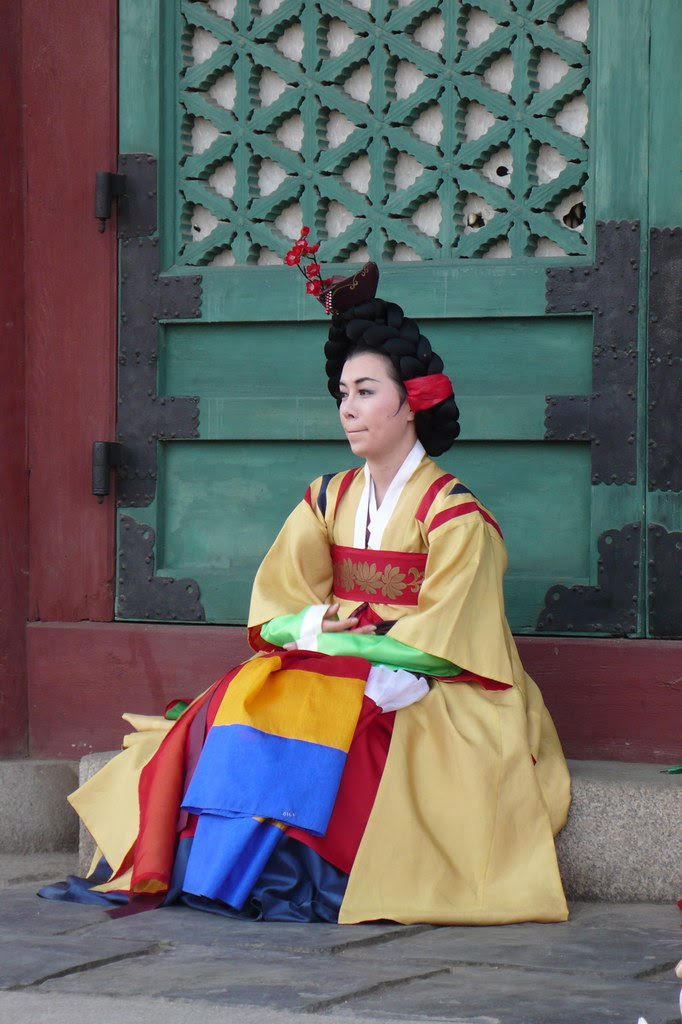 Lady performer in Traditional Korean dress preparing to go on stage