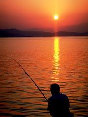 Fisherman at sunset - Edipsos Port