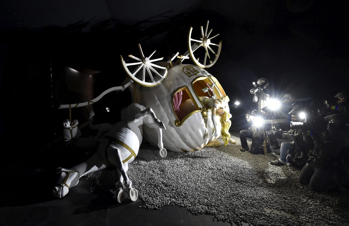 Cinderella's coach has crashed outside her grungy castle, making quite a scene.