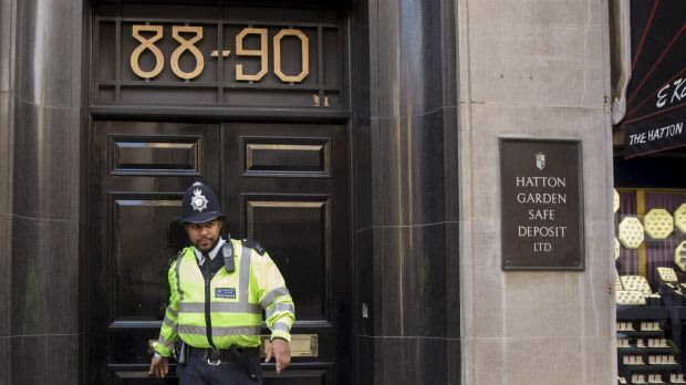 A British police officer leaves a safe deposit building on Hatton Garden.