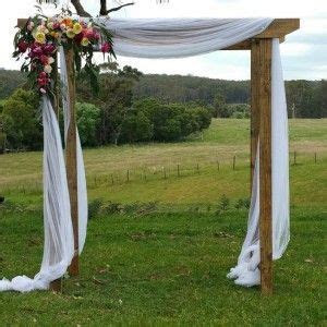 Rustic wedding arch. This timber wedding arch with draping