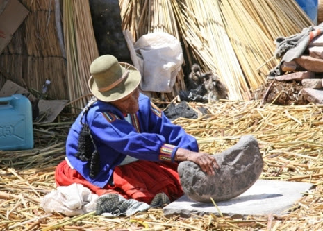 An old woman flattens reed - Floating Islands, Lake Titicaca, October 2008