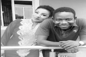 Mide Martins and hubby pose on set