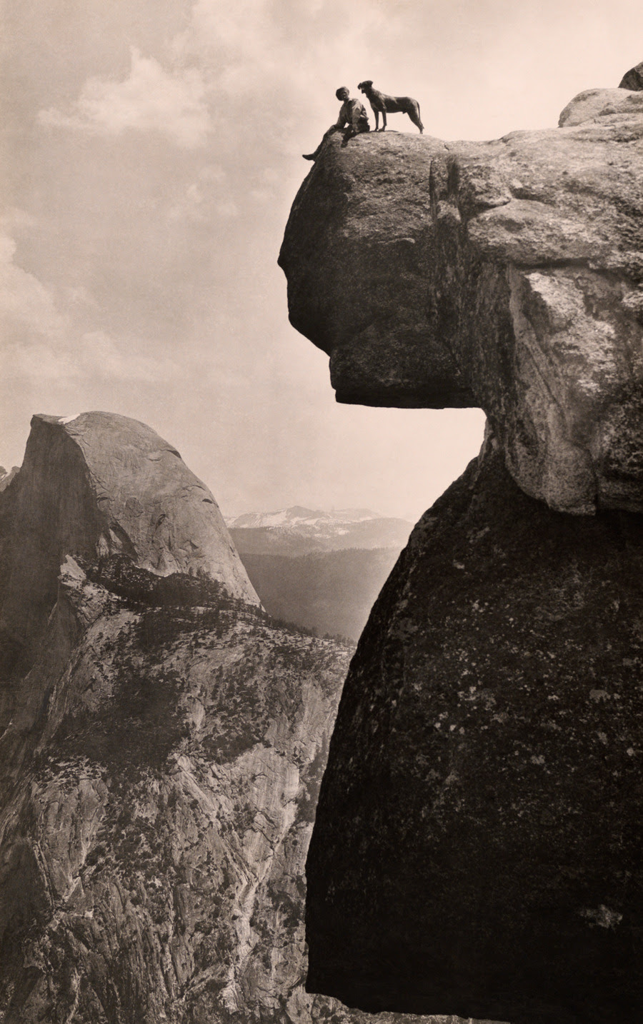 A man and his dog on the Overhanging Rock in Yosemite National Park, May 1924.Photograph by Educational-Bruce Photograph