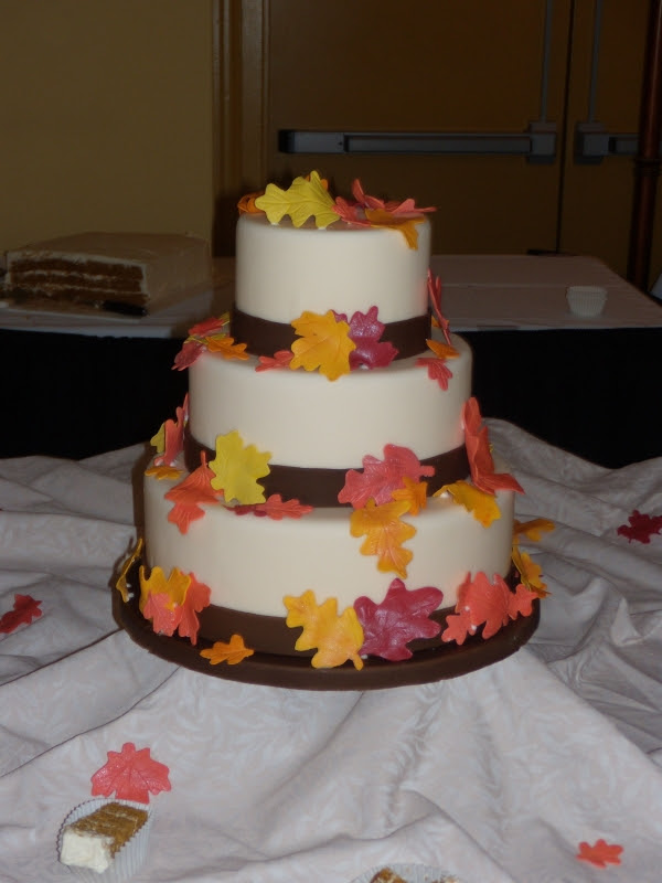 Simple autumn wedding cake Covered in fondant with gumpaste leaves TFL