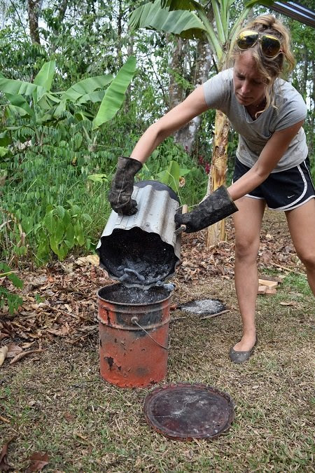 As the stove dies down, the combustion is stopped by dumping the contents into a quench bucket.