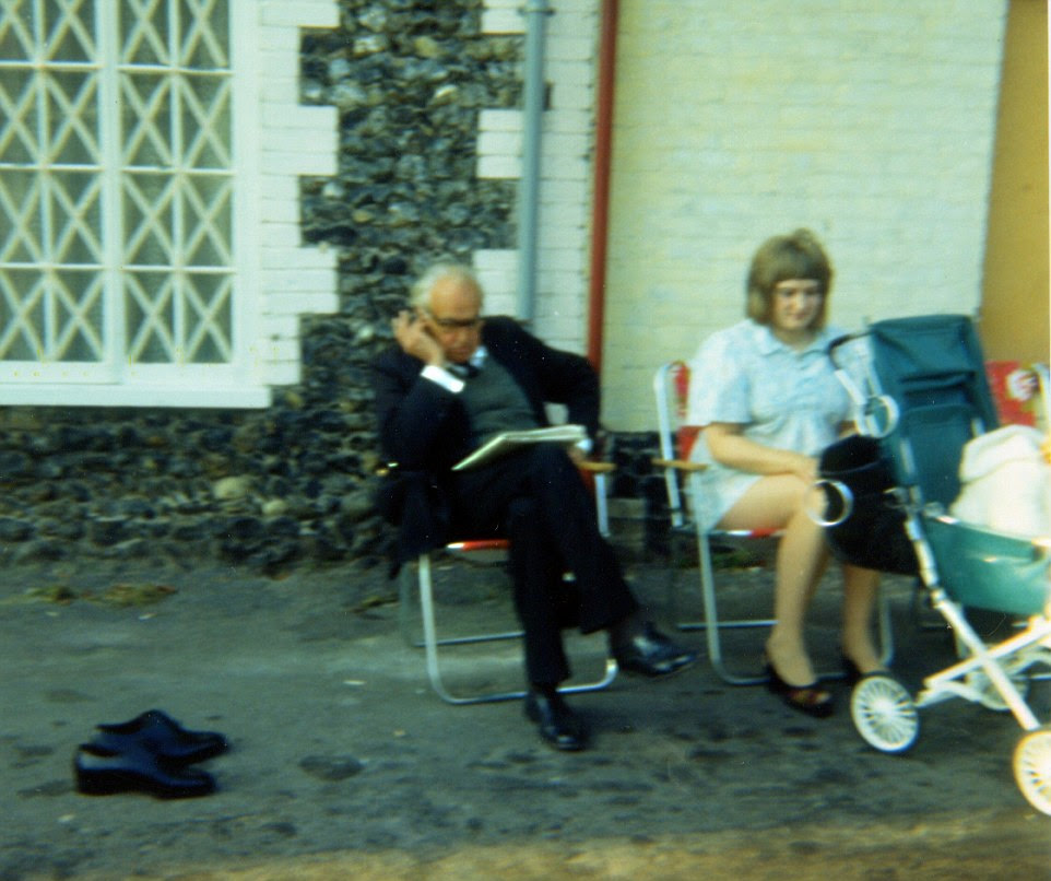 John Laurie takes on another crossword in while sitting in Nether Row, Thetford, during filming for Time On My Hands