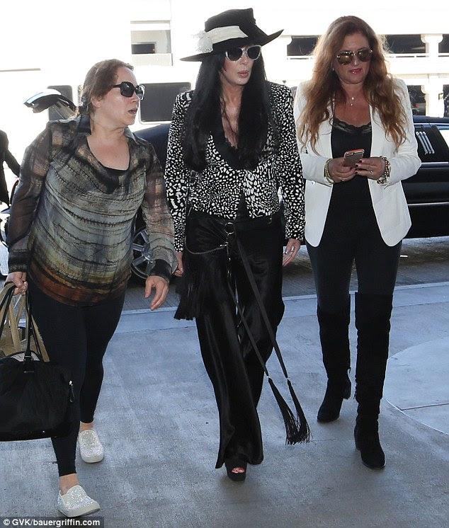 Stylish: The Believe hitmaker also rocked billowing satin trousers as she strut her stuff in peep-toe platform heels
