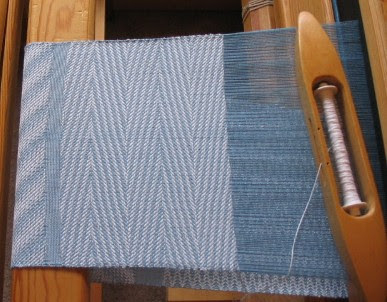 Experiment in advancing twill treadling reverses.