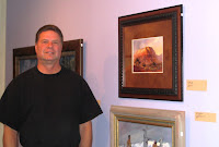 Artist Roland Lee standing in front of his painting selected for the 84th annual Spring Salon of the Springville Museum of Art in Springville Utah