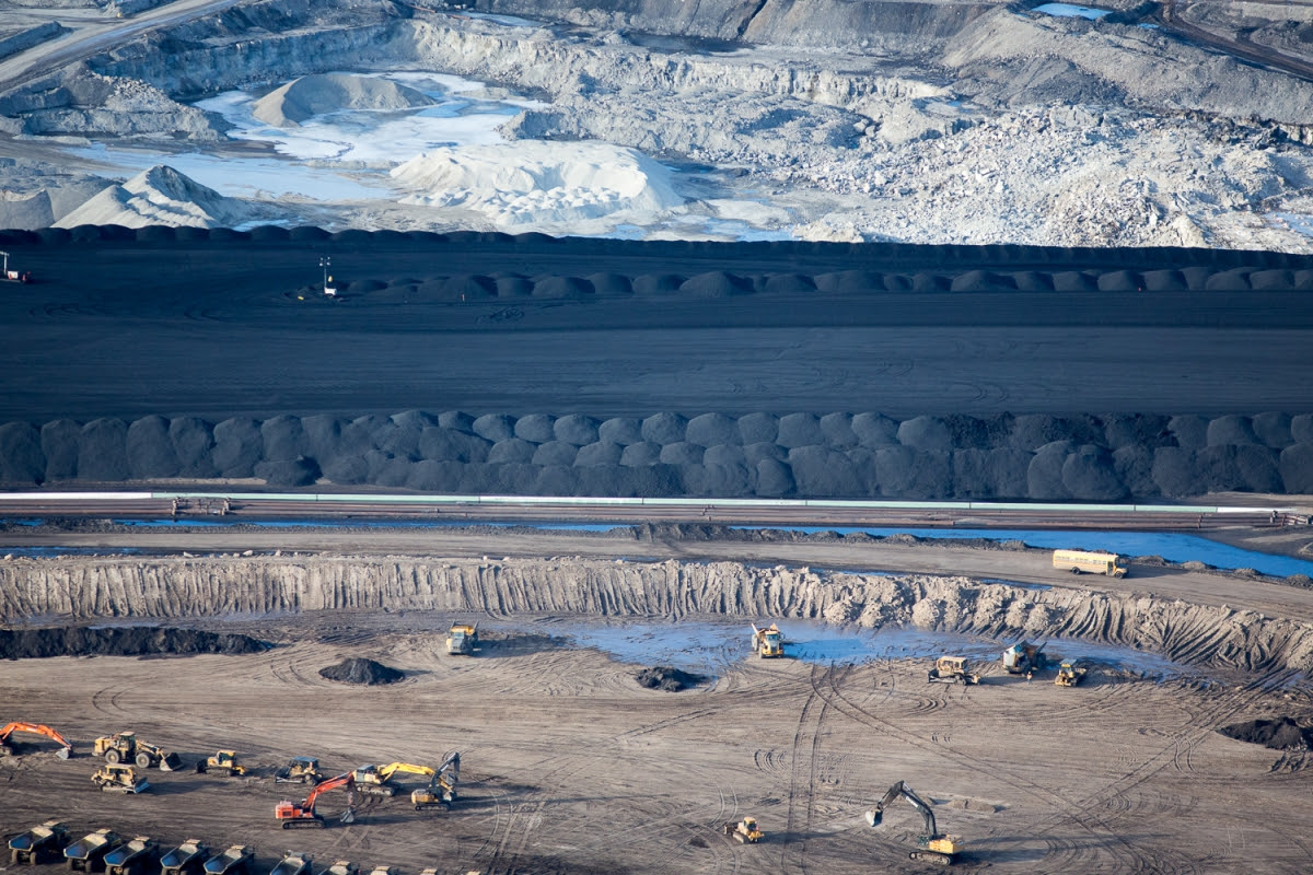 """Suncor Oil Sands Project. Piles of uncovered petrolum coke, a byproduct of upgrading tar sands oil to synthetic crude. """"Petcoke"""" is between 30-80 per cent more carbon intense than coal per unit of weight."""