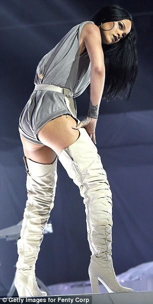 She's a bit cheeky: As to be expected, Rihanna's outfits showed off plenty of flesh - particularly her pert posterior