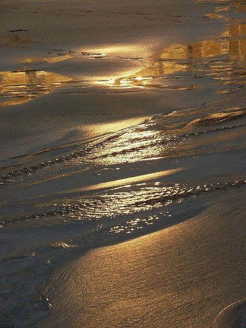 the beaches sand becomes gold at dusk - looks just like melting gold