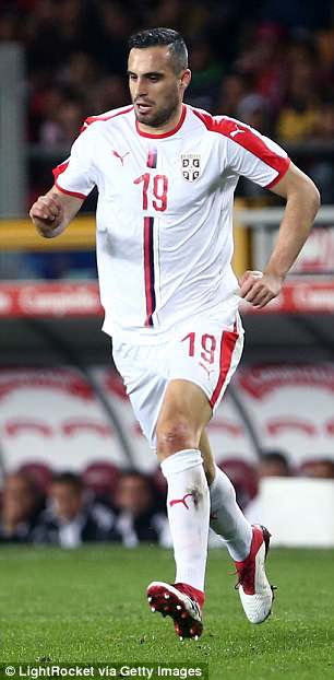 Serbia's away kit features the national flag as opposed to the more conservative home shirt