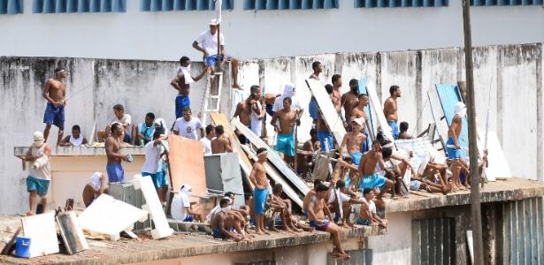 16jan2017-em-novo-motim-presos-sobem-nos-telhados-do-no-presidio-de-alcacuz-regiao-metropolitana-de-natal-rn-1484576861623_615x300 (1)