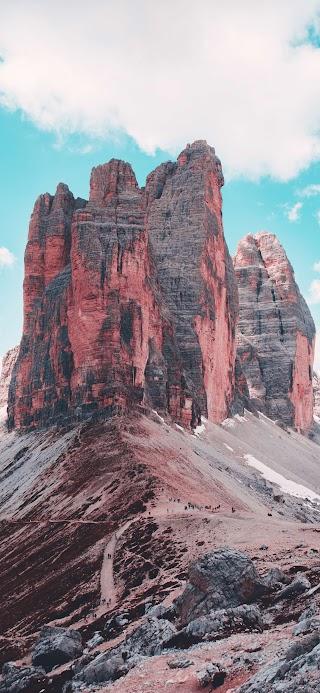 Brown rocky mountain under blue sky wallpaper